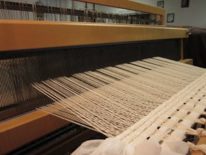 Shafts lift the yarn