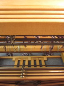 The heddles slide along 4 shafts