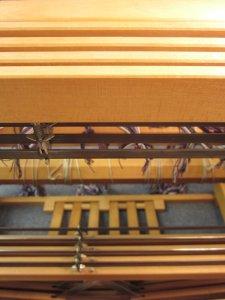 The heddles slide along 4 shafts