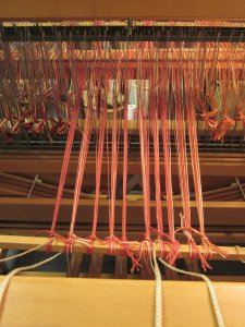 Pulling the yarn through to tie on