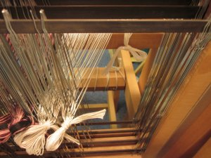 Sliding the heddles over one at a time!