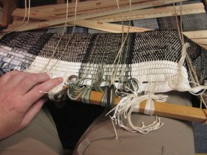 Untying the fabric from the rod.