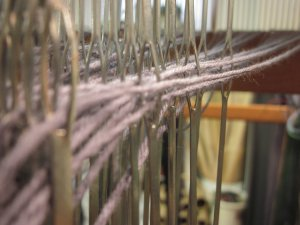 From the reed, through the heddles!