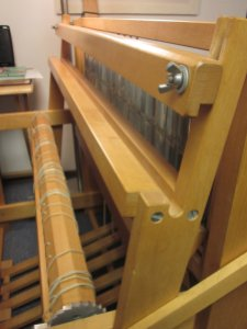 The beater bar at the front of the loom