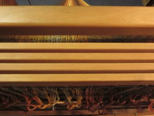 The path through the belly of the loom.