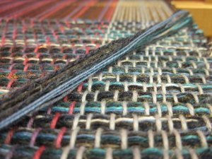 Take a peek at the weft yarns...