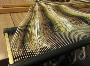 Each yarn is placed in a dent of the reed.